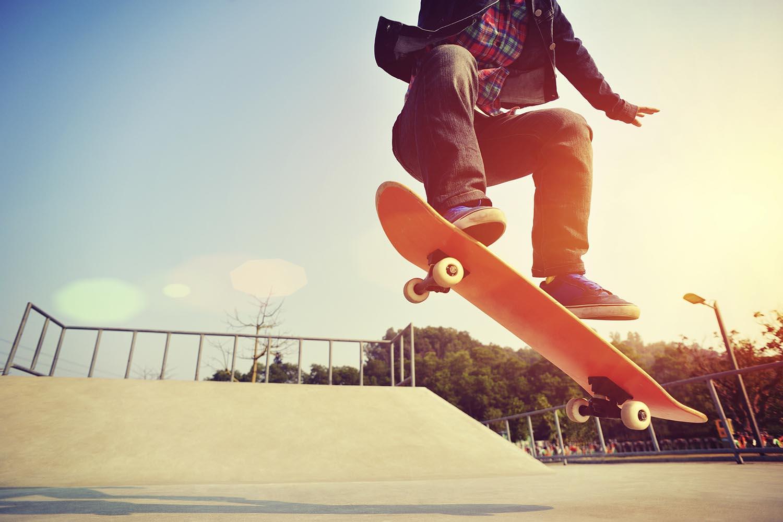 skateboarding  jumping at  sunrise skatepark